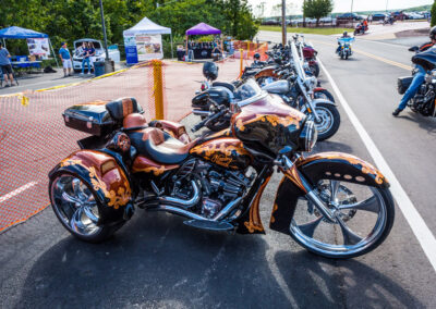 HD tric with special orange, red, and black paint job