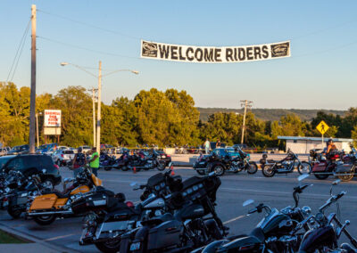 Welcome Riders sign on the strip